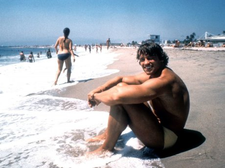 Arnold Schwarzenegger relaxes at Venice Beach in 1977.